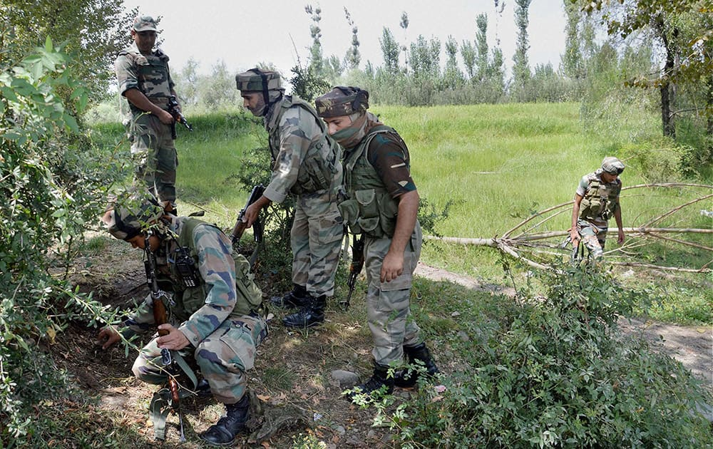 Army personnel defuse an IED set-up by militants at Moihpora in Kulgam district of South Kashmir.
