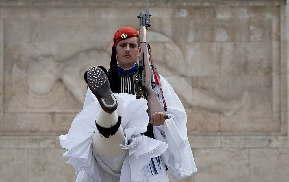 A Greek presidential guard performs during the changing of the guards ceremony at the tomb of the unknown soldier in central Athens.