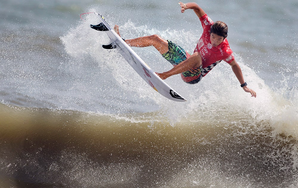 Kanoa Igarashi, of the United States, attempts a 360 air during his win in the Vans Pro Men's final, at the 53rd annual Coastal Edge East Coast Surfing Championship.