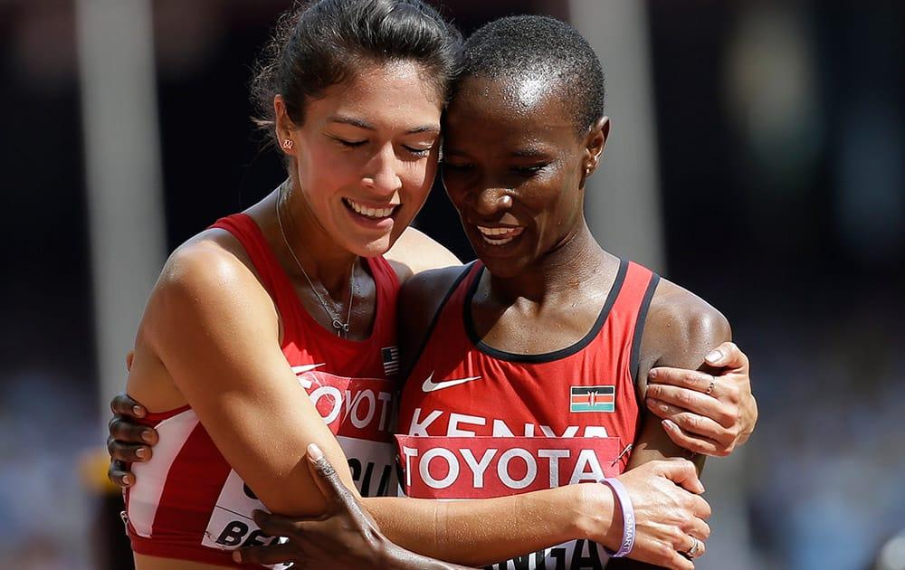 United States' Stephanie Garcia, left, and Kenya's Virginia Nyambura Nganga hug following heat one of the women's 3000m steeplechase at thebWorld Athletics Championships at the Bird's Nest stadium in Beijing.