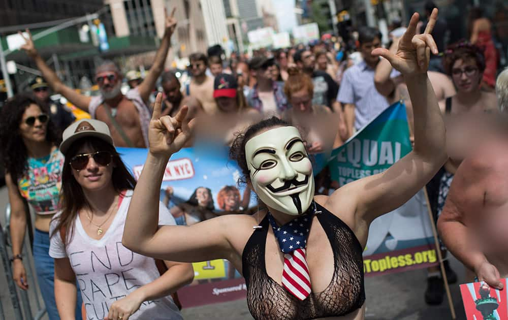 Topless activist Phoenix Feeley marches in the protest march called the GoTopless Day Parade in New York.