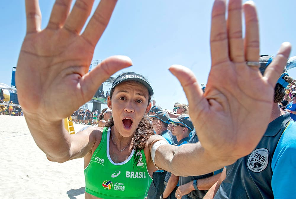 Talita Da Rocha Antunes high-fives the photographers after winning gold at the FIVB World Series of Beach Volleyball event in Long Beach, Calif.
