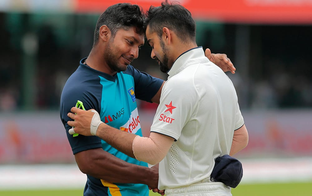 Indian cricket captain Virat Kohli greets Sri Lankan cricketer Kumar Sangakkara after the second test cricket match between Sri Lanka and India in Colombo, Sri Lanka.