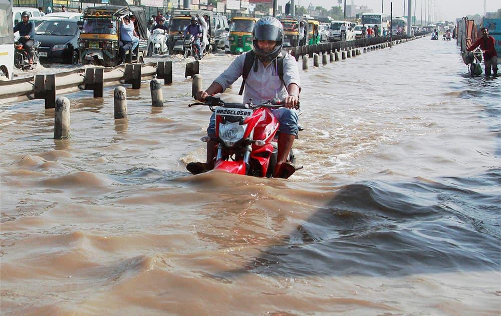 Waterlogging at Hero Honda Chowk at Delhi-Gurgaon Expressway after heavy rains in Gurgaon.