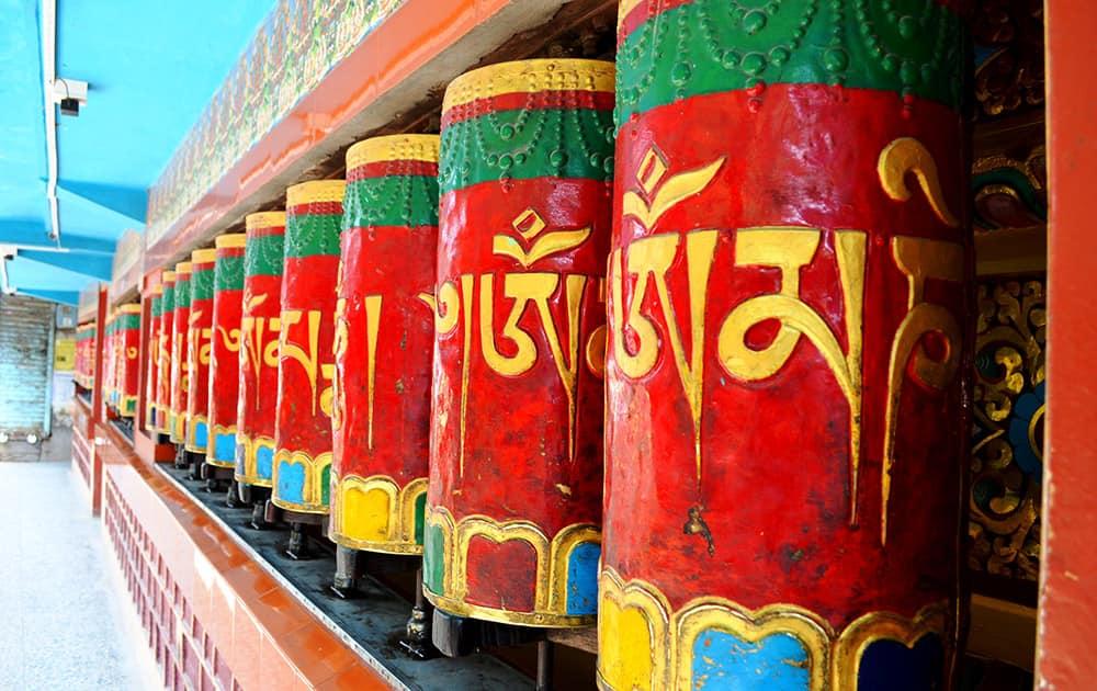 Constantly spinning Buddhist prayer wheels.