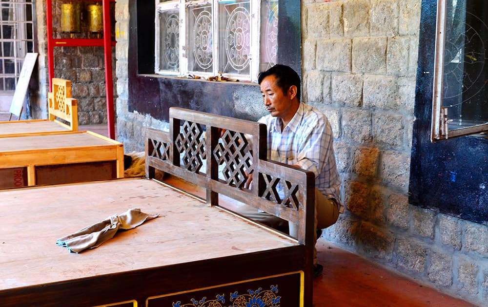 An artisan finishing off a bed at the Norbulingka Institute.