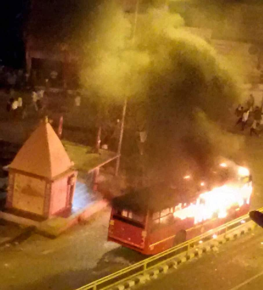 A bus set on fire in Surat on Tuesday by people after the arrest of Hardik Patel, convener of Patidar Anamat Andolan Samiti.