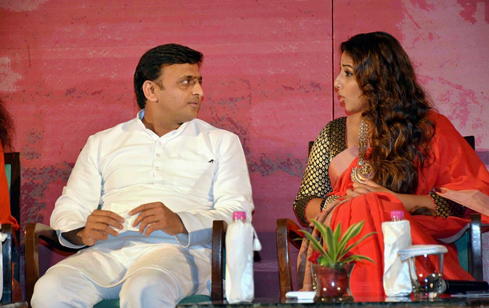 Uttar Pradesh Chief Minister Akhilesh Yadav and actress Vidya Balan during a Swachh Banega India programme in Lucknow.