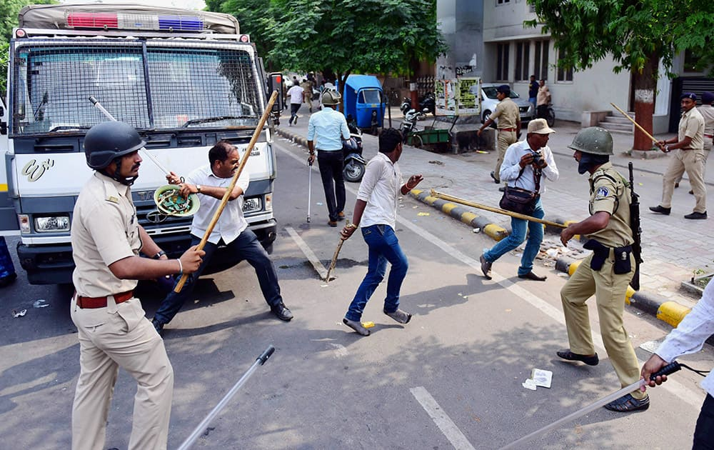 Police lathicharge Patel community members after their agitation for reservation turned violent in Ahmedabad.
