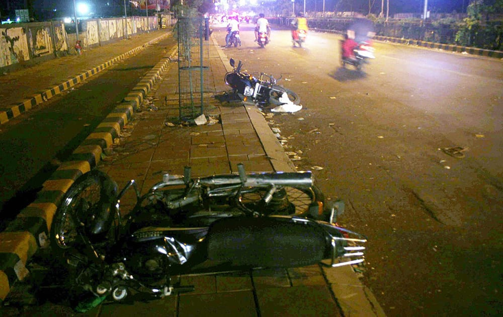 Motorbikes damaged by people after the arrest of Hardik Patel, convener of Patidar Anamat Andolan Samiti, in Ahmedabad.