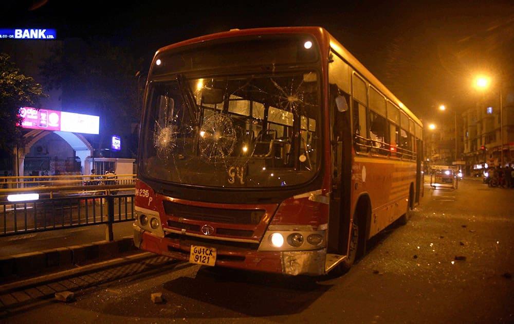 A bus damaged by people after the arrest of Hardik Patel, convener of Patidar Anamat Andolan Samiti, in Ahmedabad.
