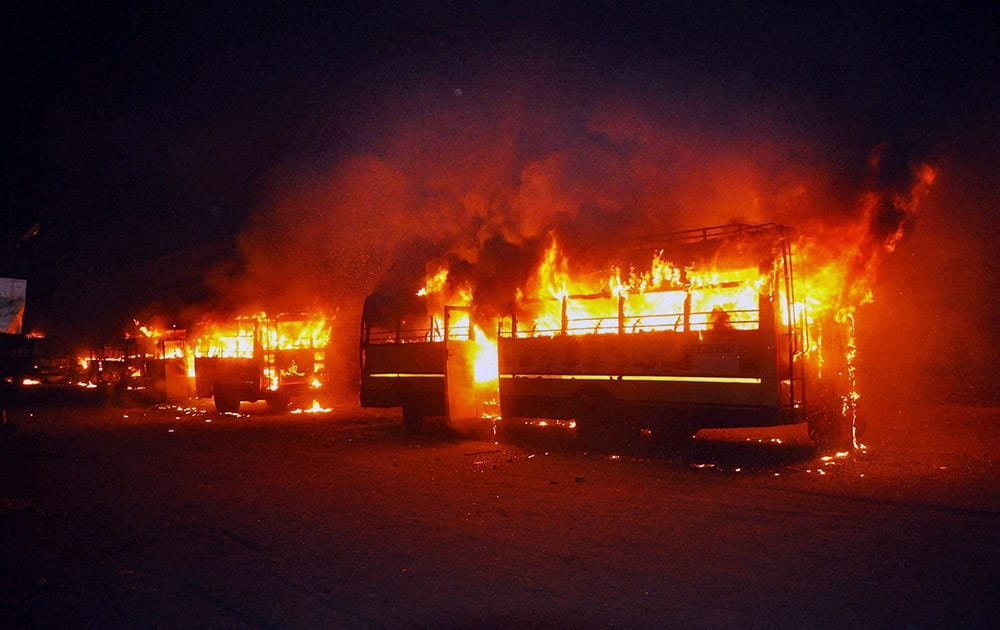 Buses set on fire in Surat on Tuesday night by people after the arrest of Hardik Patel, convener of Patidar Anamat Andolan Samiti.