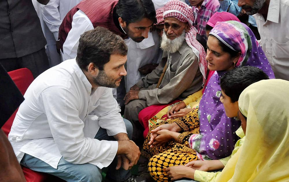 Congress Vice President Rahul Gandhi with JKPCC President Ghulam Ahmad Mir meeting with the people affected by Pakistani firing in areas along the Line of Control at Balakot sector in Poonch.