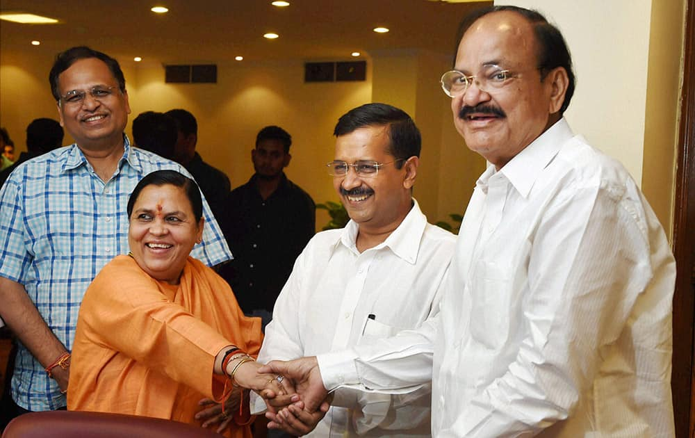 Union Water Resources Minister Uma Bharti, Urban Development Minister M. Venkaiah Naidu and Delhi Chief Minister Arvind Kejriwal during a meeting for Yamuna Rejuvenation at the Nirman Bhavan, in New Delhi.