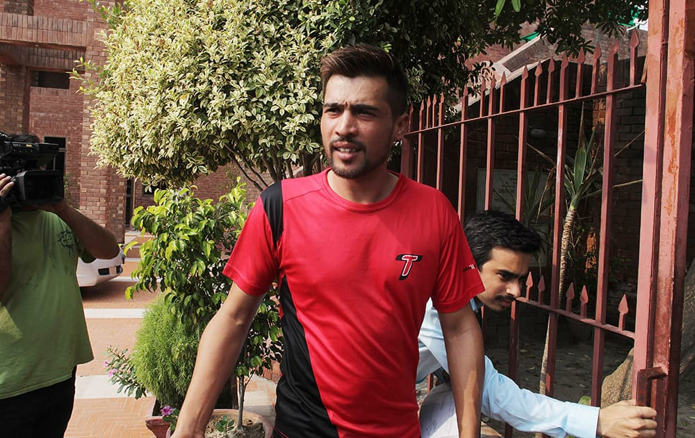 Pakistani cricketer Mohammad Amir arrives at the Pakistan Cricket Boards headquarters in Lahore, Pakistan.