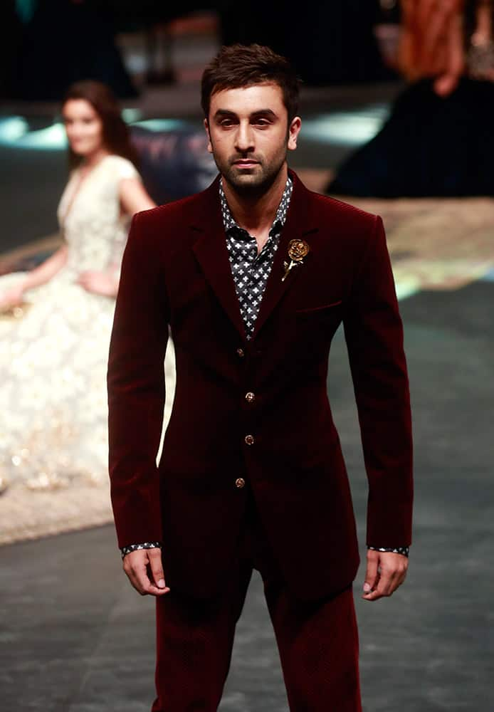 Bollywood actor Ranbir Kapoor displays a creation by designer Manish Malhotra, during Lakme Fashion Week in Mumbai, India.