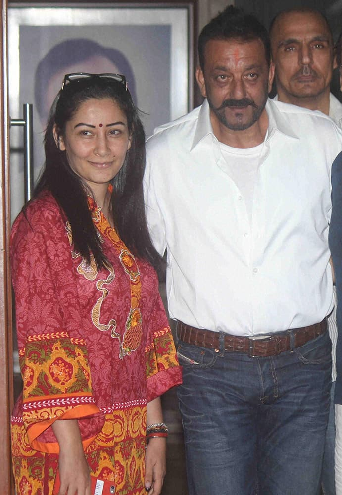 Actor Sanjay Dutt with his wife Manyata in Mumbai on Wednesday, after he released on 30 days furlough from Yerwada Jail.