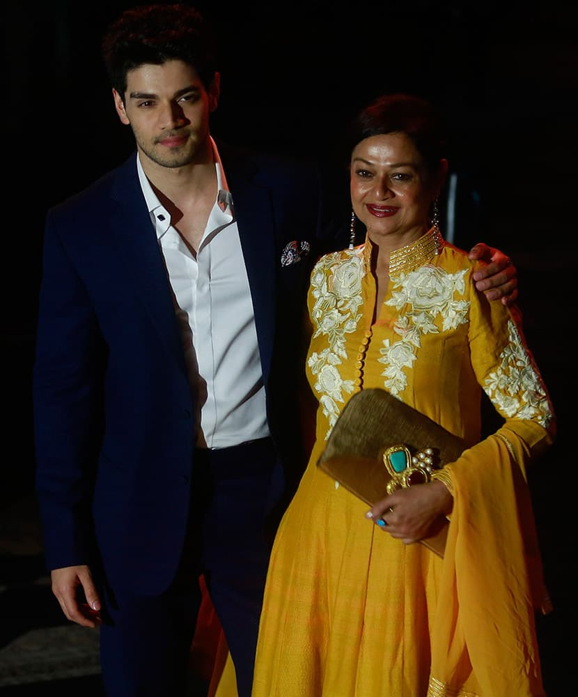 Bollywood actor Sooraj Pancholi left, along with his mother Zarina Wahab posses for a picture during the Lakme Fashion Week in Mumbai.