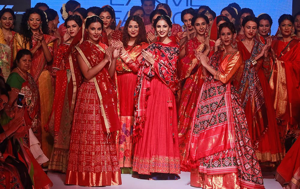 Models present creations of designer Gaurang during the Lakme Fashion Week in Mumbai.