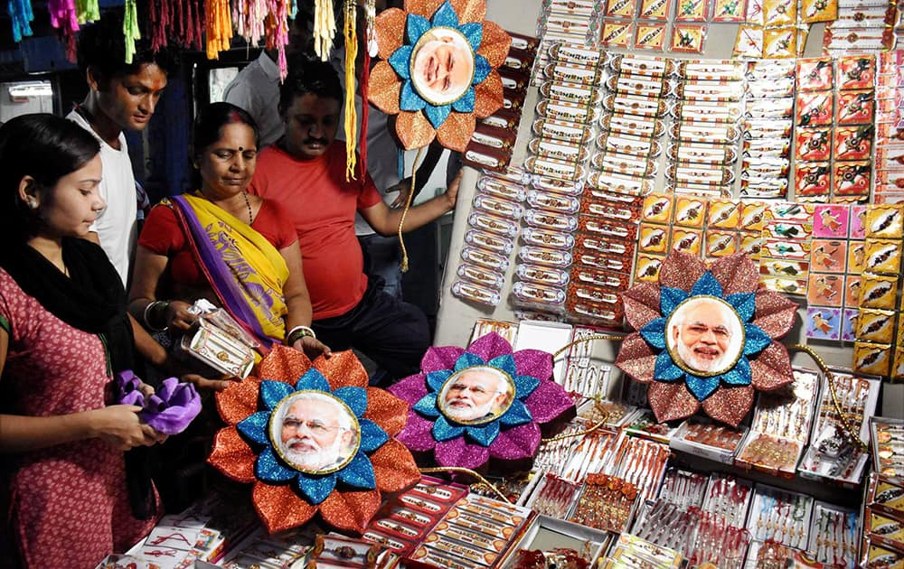 Women buying Rakhi with picture of PM Narendra Modi at shop in Patna.