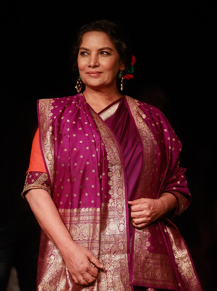 Shabana Azmi poses for photographs during the Lakme Fashion Week in Mumbai.