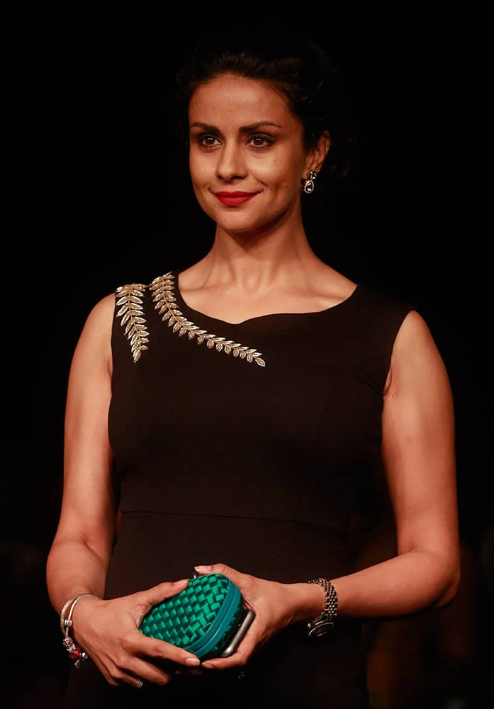 Gul Panag poses for photographs during the Lakme Fashion Week in Mumbai.
