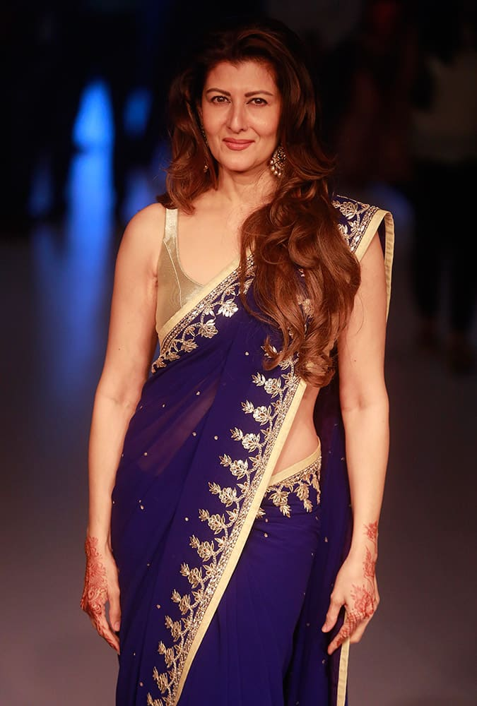 Sangeeta Bijlani posses for a picture during the Lakme Fashion Week in Mumbai.