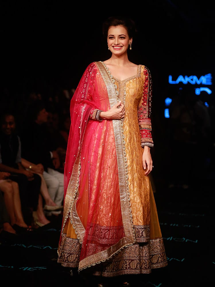 Dia Mirza poses for photographs during the Lakme Fashion Week in Mumbai.
