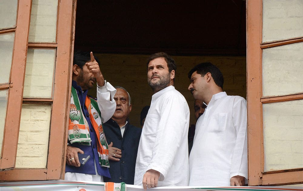 Congress Vice President Rahul Gandhi is briefed by JKPCC chief Ghulam Ahmad Mir about the devastation by the last years floods, at the party headquarters in Srinagar.