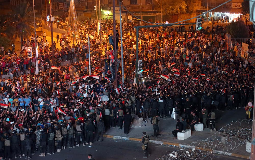 Iraqi security forces close a bridge leading to the heavily guarded Green Zone during a demonstration in support of Iraqi Prime Minister Haider al-Abadi in Tahrir Square in Baghdad, Iraq.