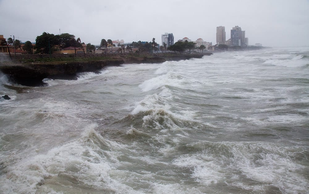 Strong winds and waves batter the coast as Tropical Storm Erika approaches Santo Domingo, in the Dominican Republic.