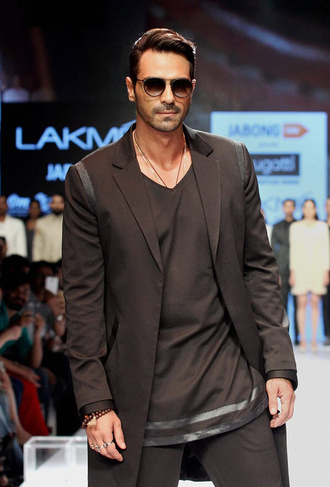 Bollywood actor Arjun Rampal showcases a creation by designer Bugatti during Lakme Fashion Week in Mumbai.