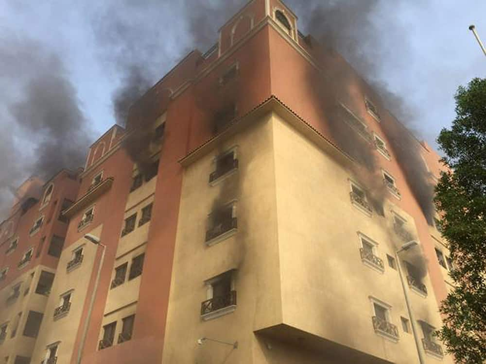In this image released by the Saudi Interior Ministry's General Directorate of Civil Defense, smoke billows from a fire at a residential complex used by state oil giant Saudi Aramco in Khobar, Saudi Arabia.