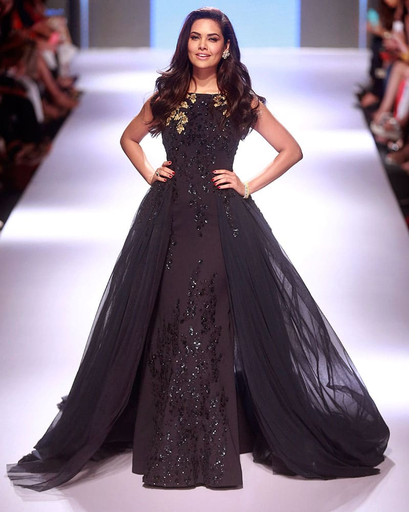 Bollywood actress Esha Gupta displays a creation by designer Ridhi Mehra during the Lakme Fashion Week in Mumbai.
