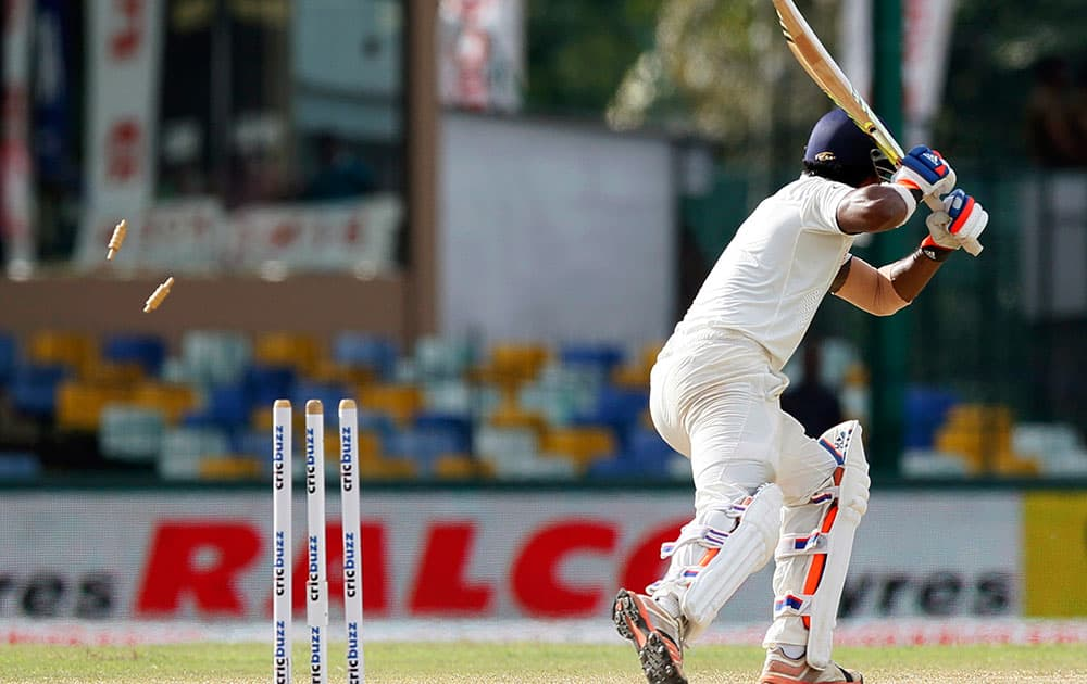India's Lokesh Rahul is bowled out off a delivery by Sri Lanka's Nuwan Pradeep on the third day of their third test cricket match between them in Colombo, Sri Lanka.