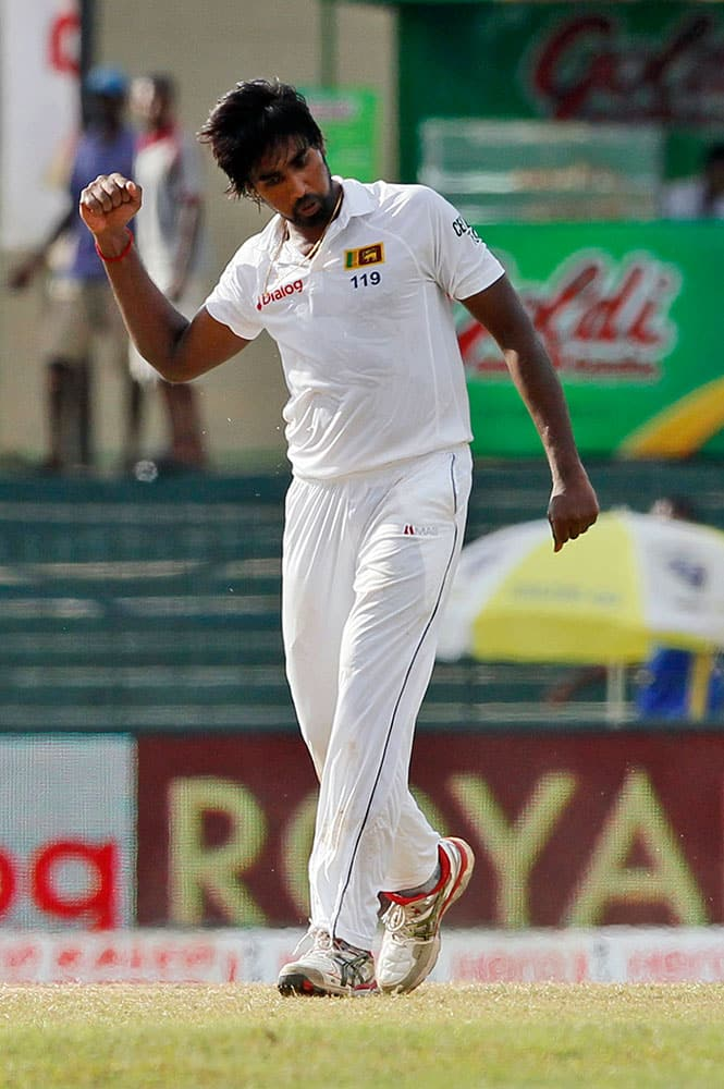 Sri Lanka's Nuwan Pradeep celebrates the dismissal of India's Lokesh Rahul on the third day of their third test cricket match between them in Colombo, Sri Lanka.