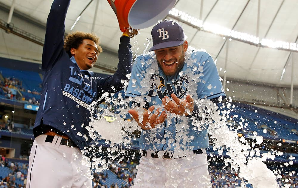 Tampa Bay Rays' Kevin Kiermaier, right, is doused with ice by Chris Archer to celebrate a 3-2 win over the Kansas City Royals in a baseball game in St. Petersburg, Fla.