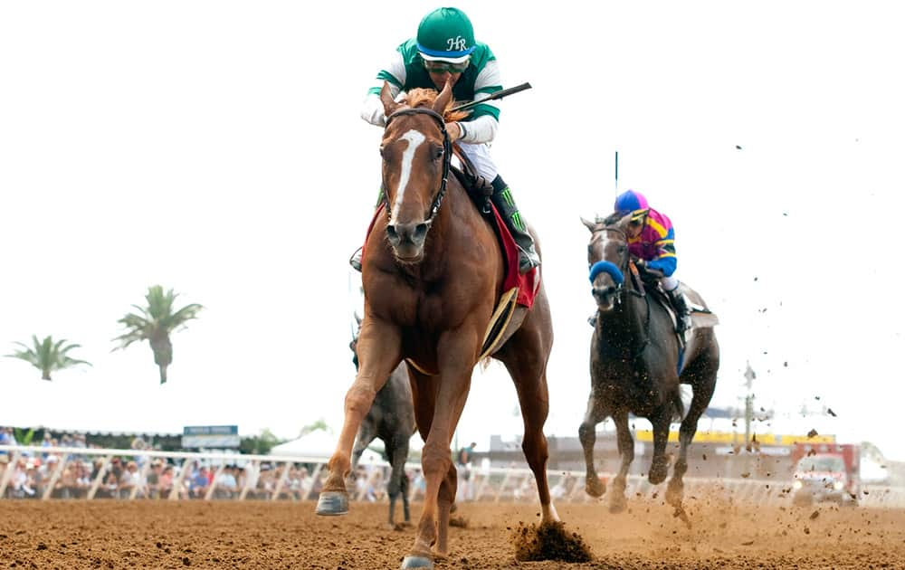Stellar Wind, foreground, with Victor Espinoza aboard, wins the Grade III, $100,000 Torrey Pines Stakes horse race at Del Mar Thoroughbred Club in Del Mar, Calif.