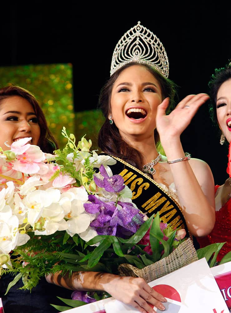 Emerald Nyein, winner of Miss Myanmar International 2015, waves during Miss Myanmar International 2015 contest at the National Theater