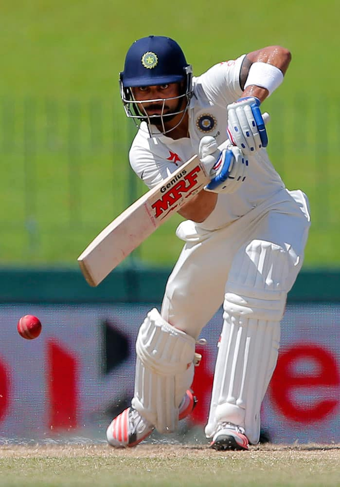 India's Virat Kohli plays a shot on day four of the third cricket test match against Sri Lanka in Colombo, Sri Lanka.