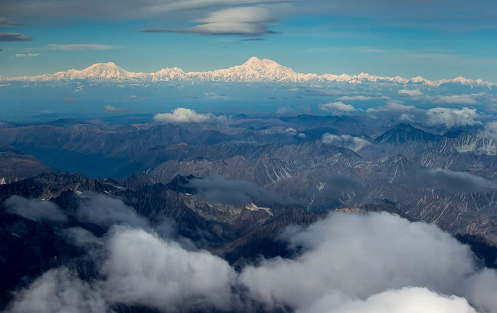 The newly-renamed Denali, top center, is seen from a window of Air Force One on approach to Anchorage, Alaska.