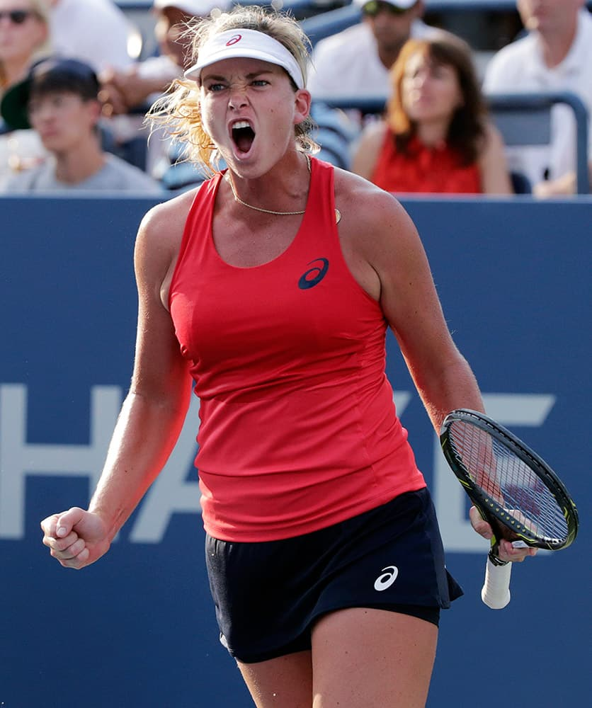 Coco Vandeweghe, of the United States, reacts after beating Sloane Stephens, of the United States, during the first round of the US Open tennis tournament.