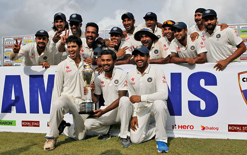 Indian cricketers pose with the trophy after they won the test cricket series against Sri Lanka in Colombo, Sri Lanka. India won the third cricket test match by 117 runs and the series by 2-1.