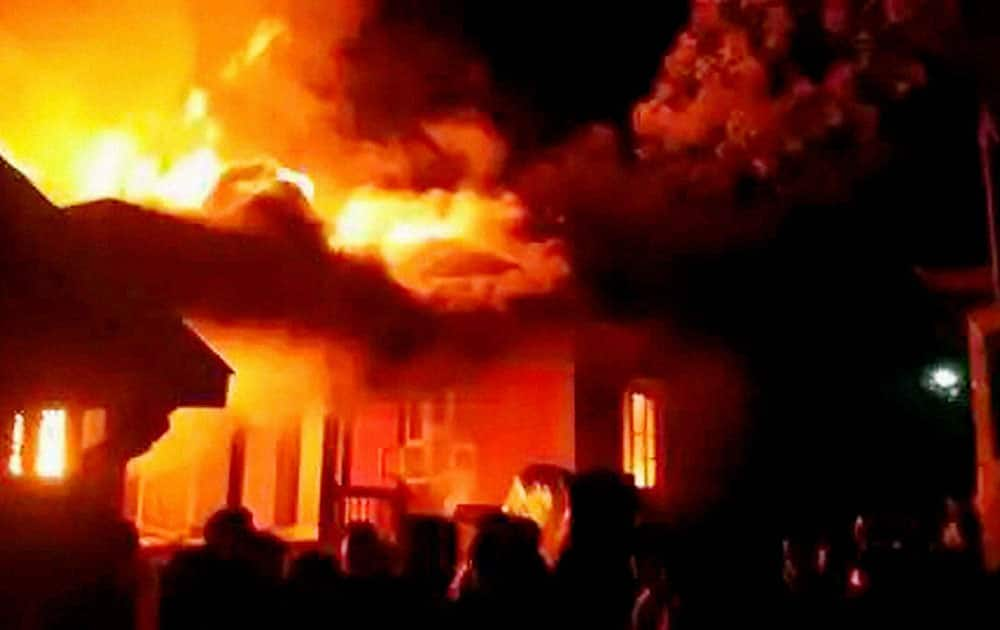 "A mob set ablaze the residences of a Manipur minister and two other legislators in Imphal on Monday evening to protest against the passage of allegedly ""anti-tribal"" bills in the 60-member assembly."