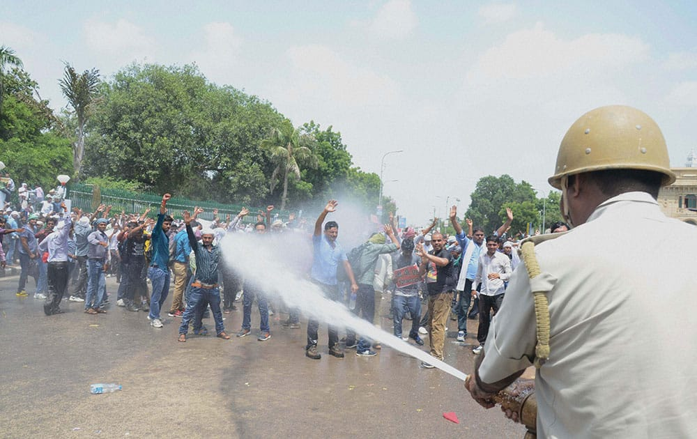 Police using water cannons to disperse B P Ed Sangharsh Morcha members during their protest for jobs in front of Vidhan Sabha in Lucknow.