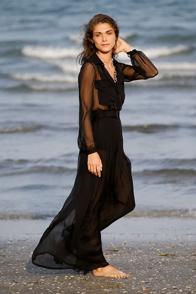 Elisa Sednaoui poses for photographers on the beach of the Venice Lido.