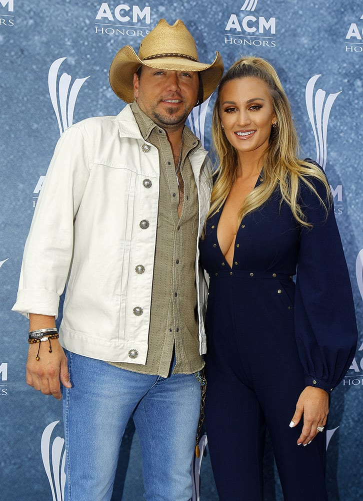 Jason Aldean and his wife Brittany Kerr arrive at the 9th Annual ACM Honors at The Ryman Auditorium in Nashville, Tenn.