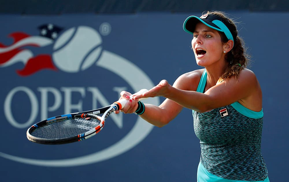 Julia Goerges, of Germany, argues a call in her match against Anna Schmiedlova, of Slovakia, during the first round of the US Open tennis tournament.