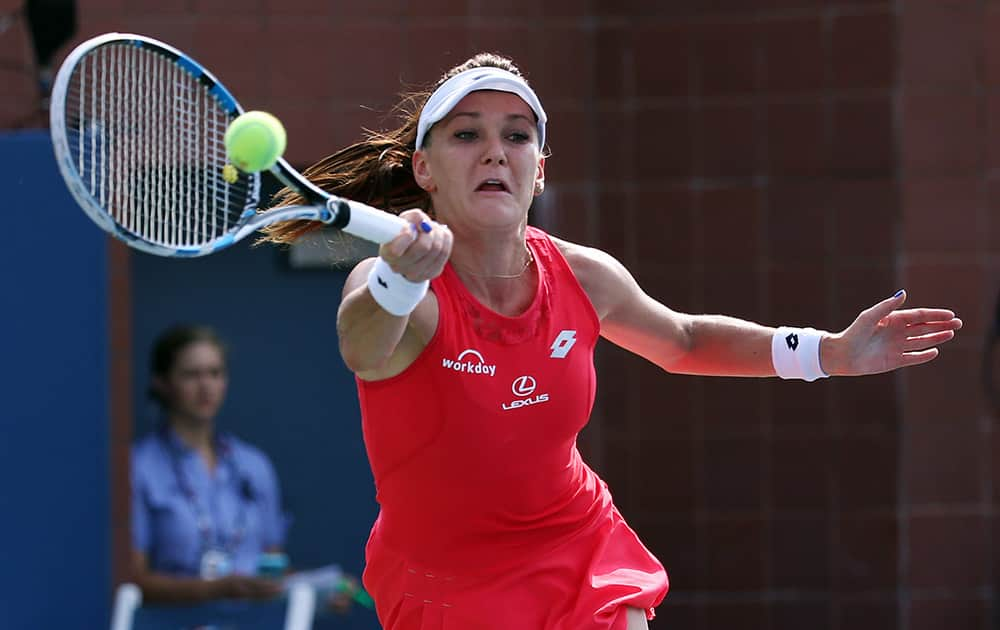 Agnieszka Radwanska, of Poland, returns a shot to Magda Linette, of Poland, during the second round of the US Open tennis tournament.