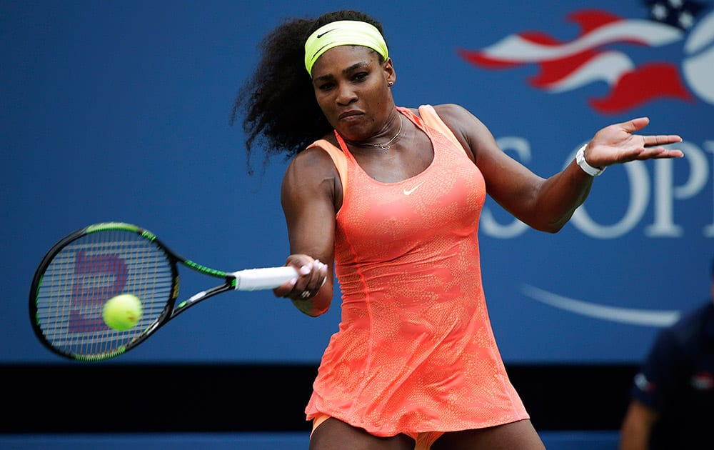 Serena Williams returns a shot to Kiki Bertens, of the Netherlands, during the second round of the US Open tennis tournament.